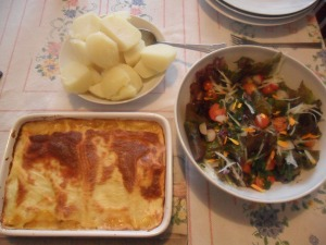 Lasagne served with homegrown potatoes and salad